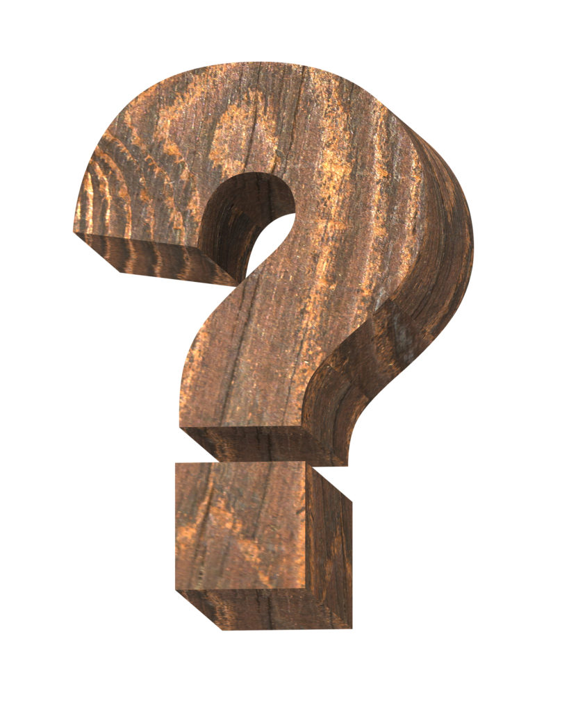 Question mark from old pine wood alphabet isolated over white.